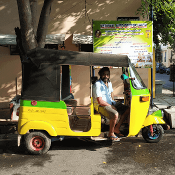 In the Image is a auto driver in Pondycherry. The popular Tuk Tuk is called an auto in India