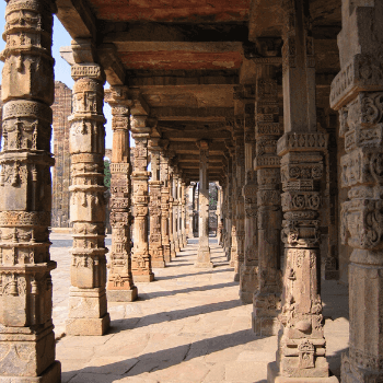 Value for money​ Travel to India with Jasmine Trails. In the Image is the cloisters of the Qutab Minar in New Delhi India.